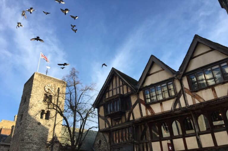 Birds flying over St Michael at the North Gate's Saxon Tower
